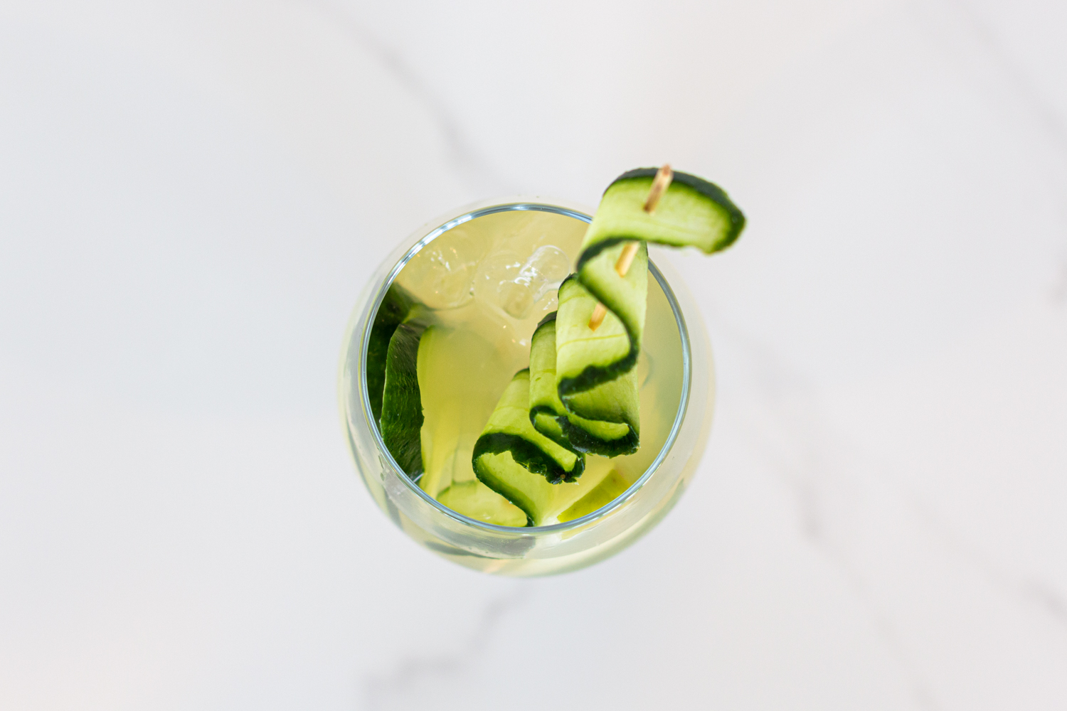 on the green cocktail with cucumber, juno gin and apple juice.